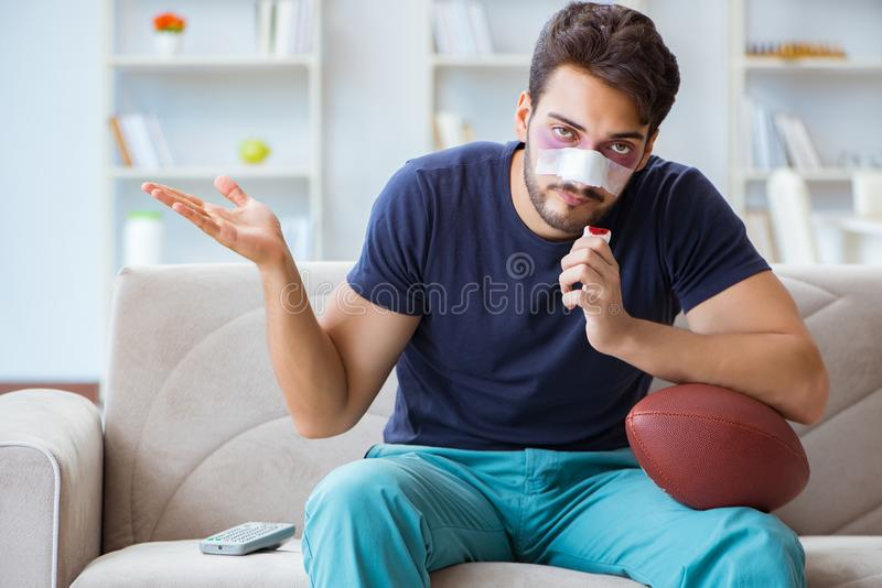 Young man defeated in sports game suffered loss with broken blee stock photography