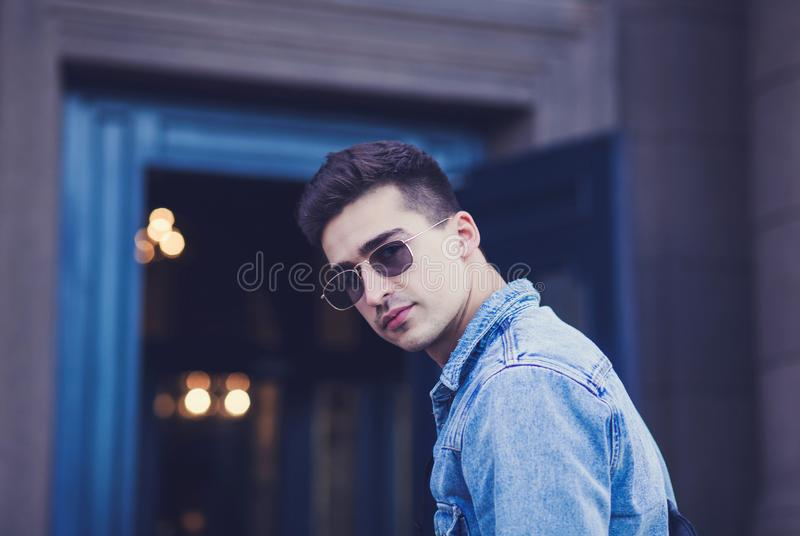 Young man in denim jacket royalty free stock photography
