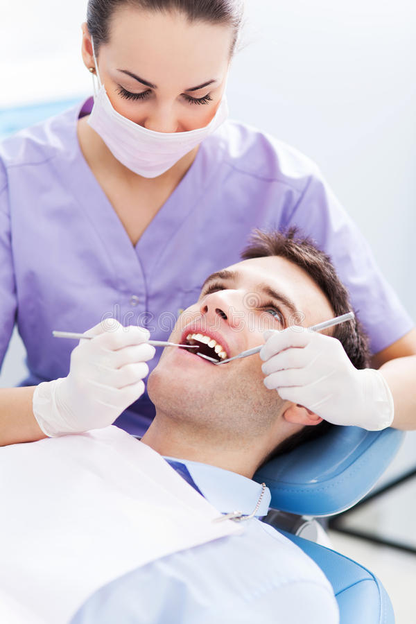 Young man at dentist office stock photos