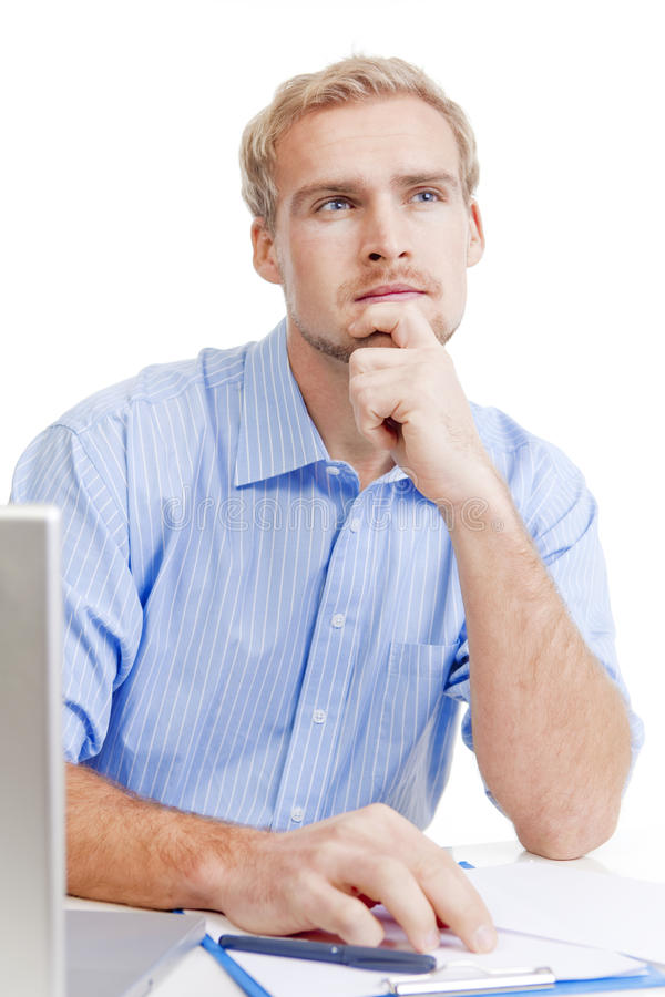 Young man at office thinking royalty free stock photo