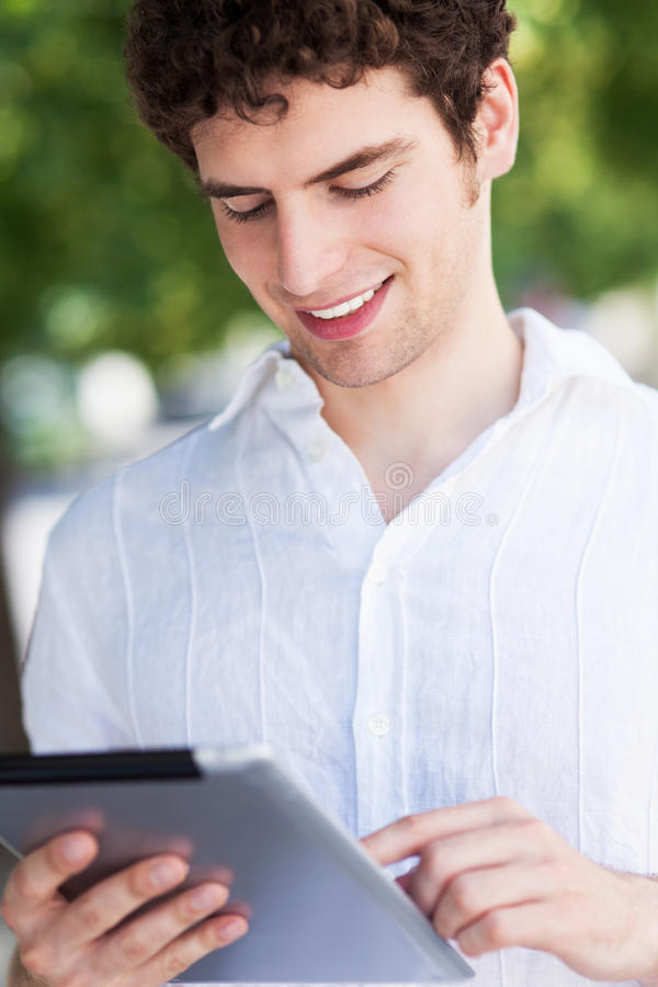 Download Young Man With Digital Tablet Stock Photo - Image: 32053836