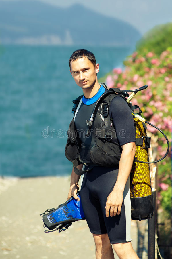 Young man in a diving suit stock image
