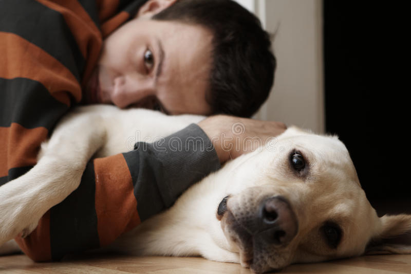 Download Young man with dog stock photo. Image of peacefully, loneliness - 17459454