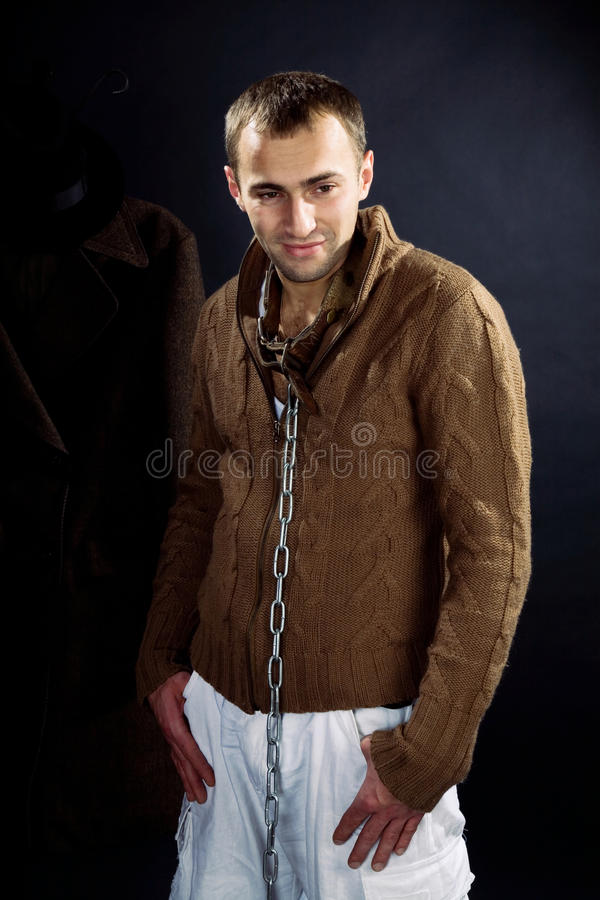 A young man in a dog collar around his neck. And chain stock image