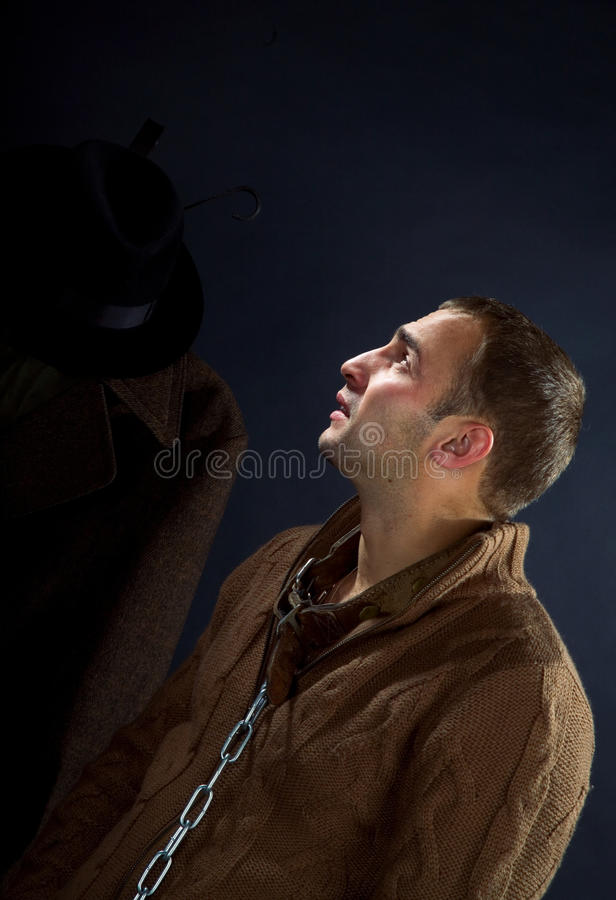 A young man in a dog collar around his neck. And chain stock photo