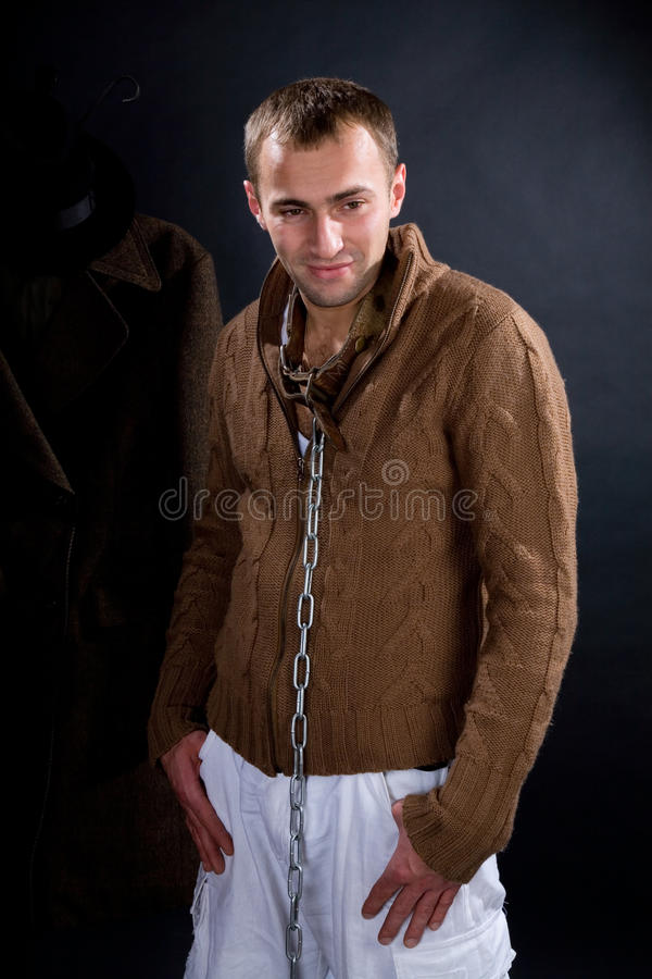 A young man in a dog collar around his neck. And chain royalty free stock photos