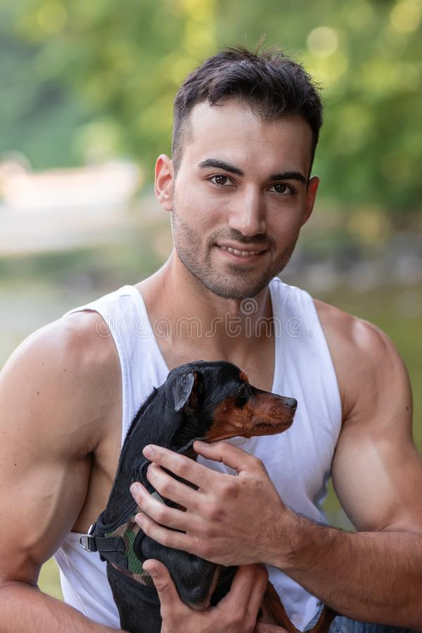 young man with dog, outdoor stock photo