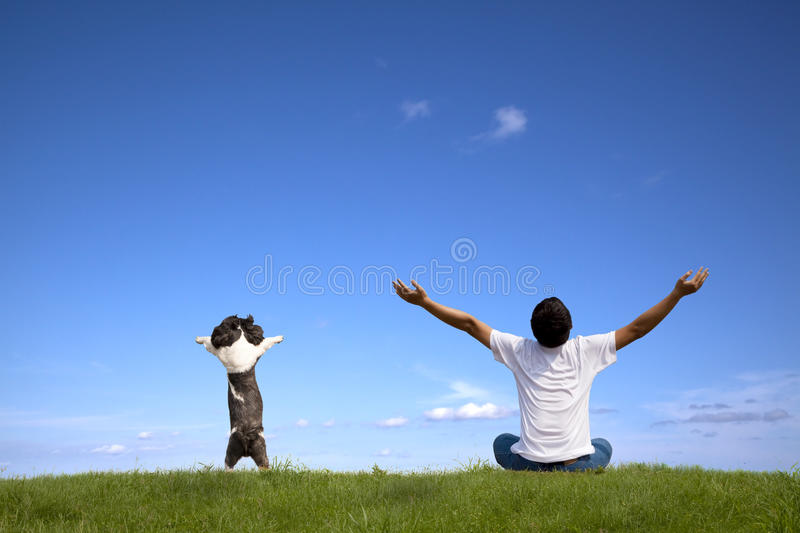 Young man with dog relaxed stock photos