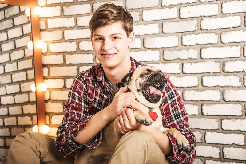 Young man with a dog. Sitting on the floor royalty free stock image