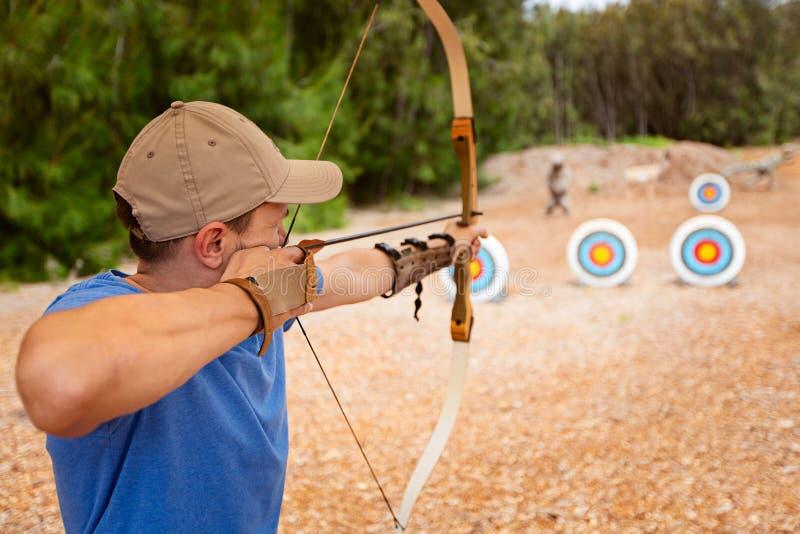 Man practicing archery stock photo