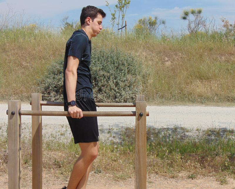 Young man doing exercise. royalty free stock photo