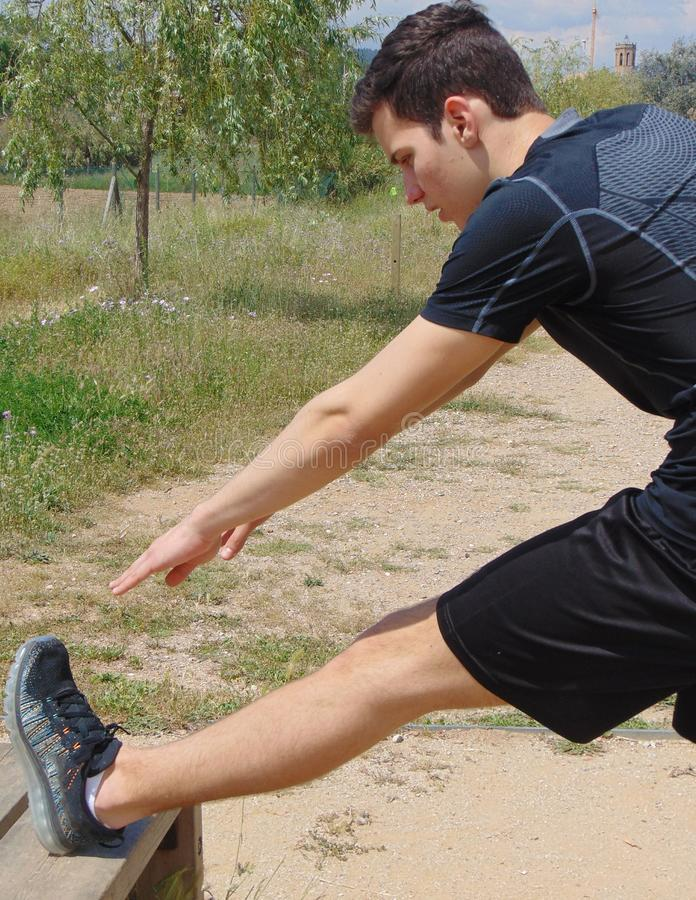 Young man doing exercise. royalty free stock images