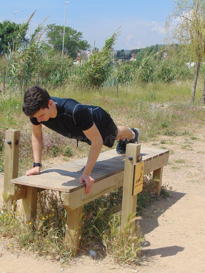 Young man doing exercise. stock photos