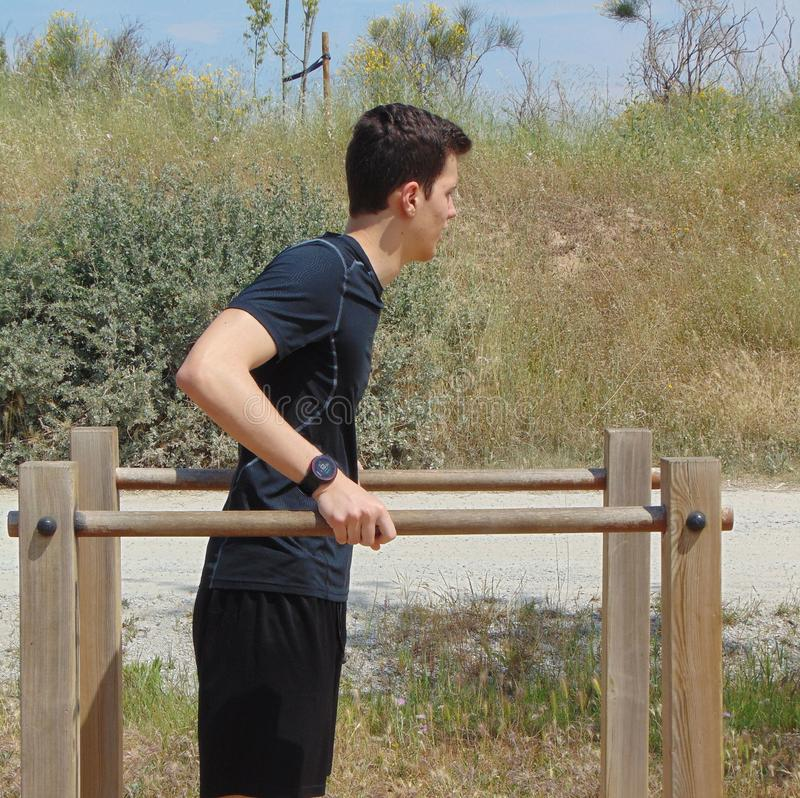 Young man doing exercise. stock image