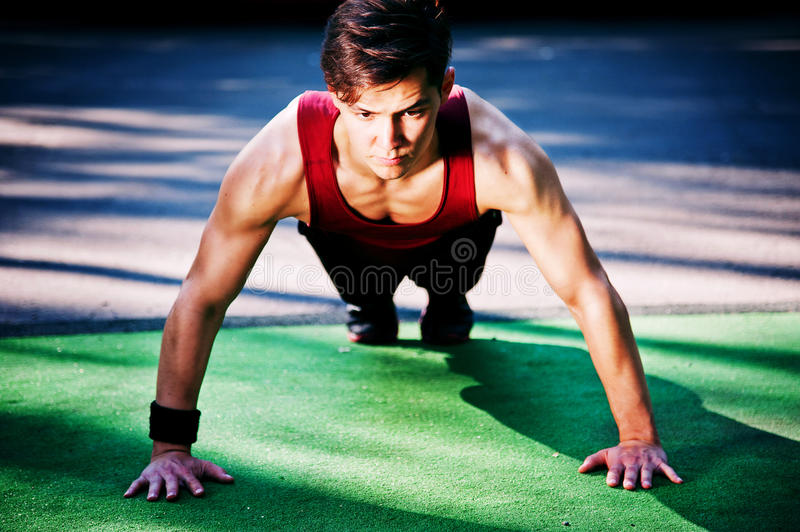 Young man doing fitness exercise stock photos