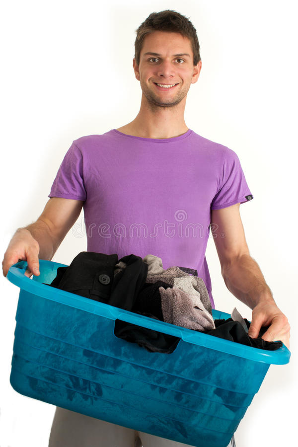 Young Man Doing The Laundry Stock Photography