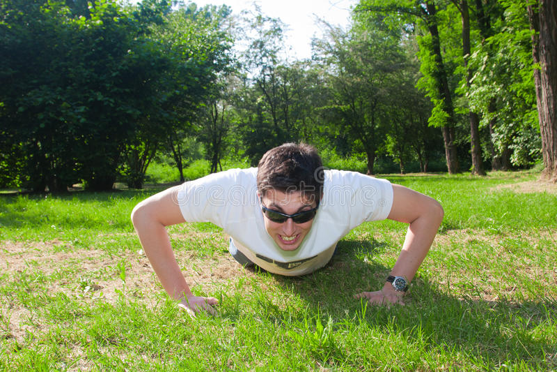 Download Young Man Doing Push Ups Stock Photo - Image: 14454360