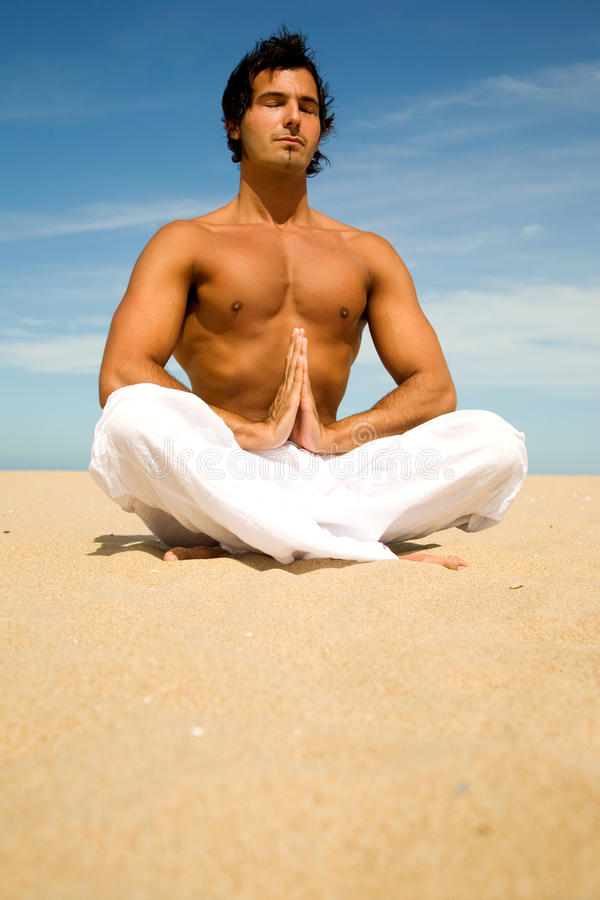 Relaxed Businessman Sitting On Tropical Beach Doing Yoga