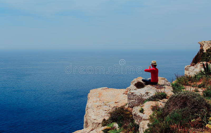Young man doing yoga in beautiful mountains royalty free stock image