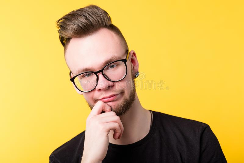 Young man doubt skepticism wary look emotion. Young man looking at camera. Doubt skepticism expression. Pursed lips. Suspicious incredulous wary bored look stock photography