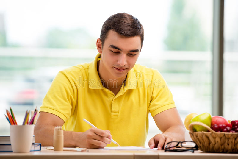 The young man drawing pictures in studio royalty free stock photos