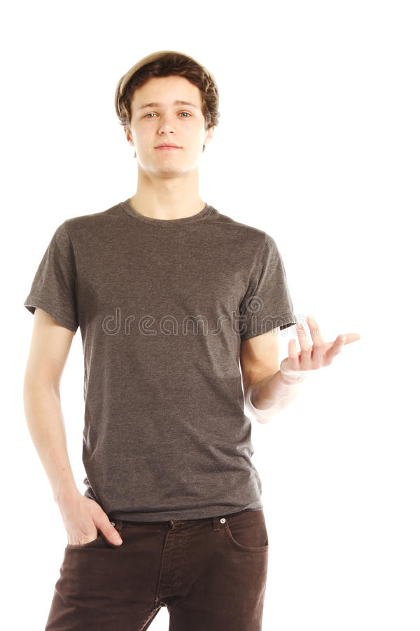 Young man dressed in hip style holding hand out stock images