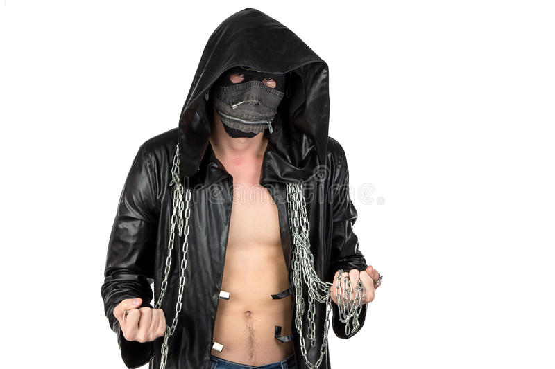 The young man dressed in hooded cloak with chain. Image of the man dressed in hooded cloak with chain on white background stock images