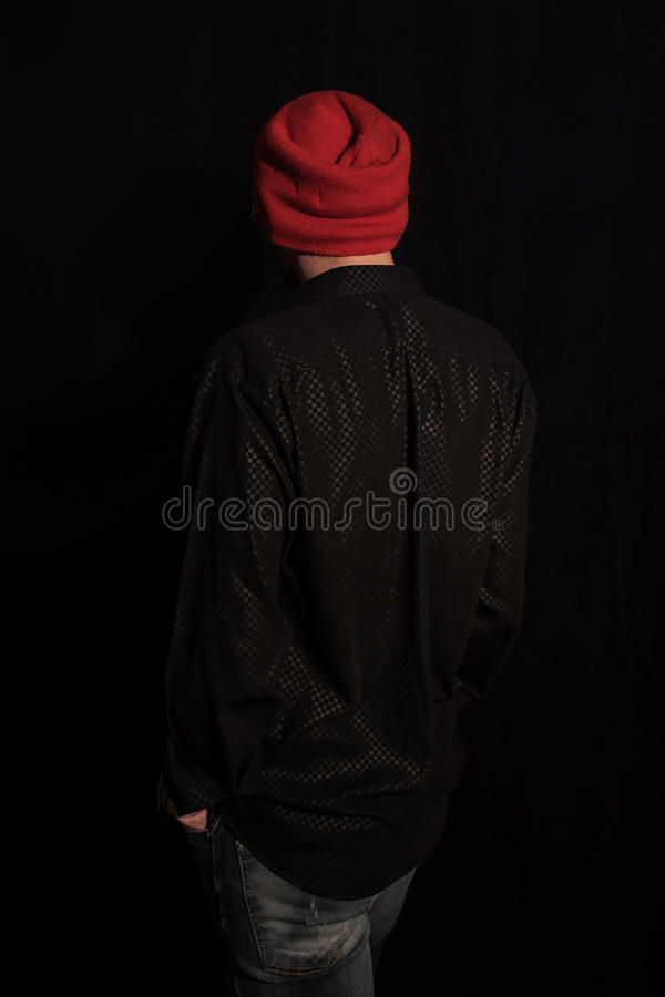 Young man dressed in modern youth clothes stock photography