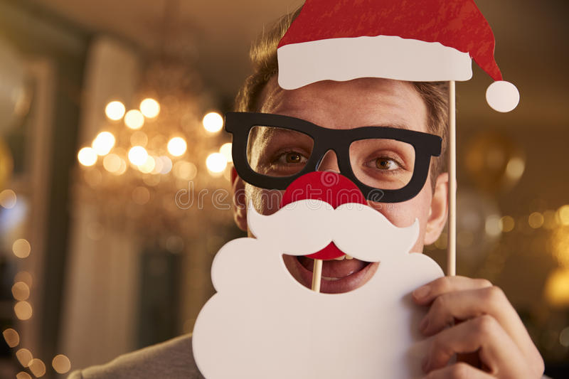 Download Young Man Dressing Up For Christmas Party Stock Photo - Image: 91320926