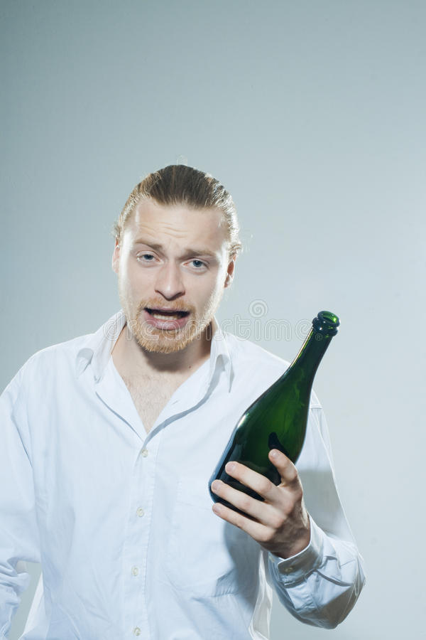 Download Young man drinking alkohol stock image. Image of bottles - 39501321