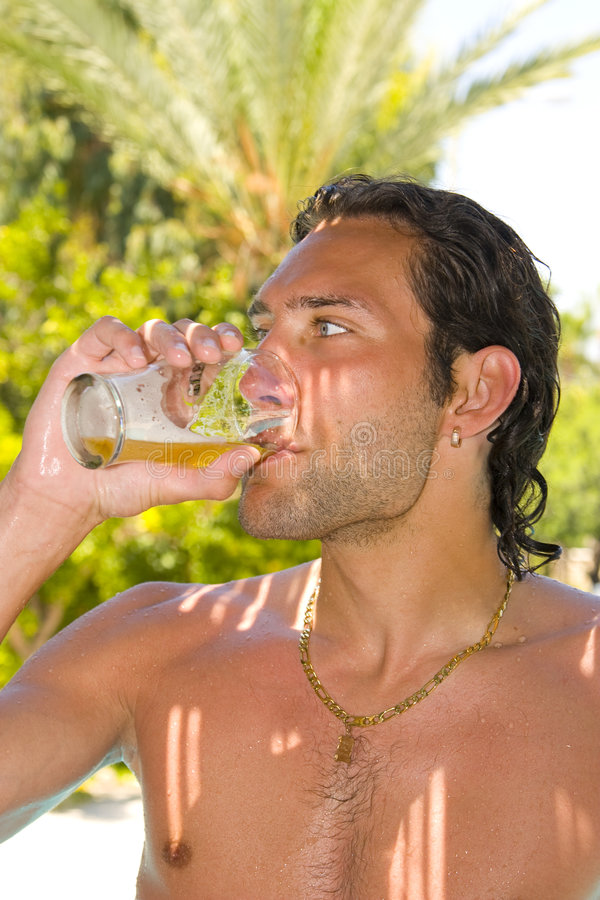 Young Man Drinking Beer Stock Photos