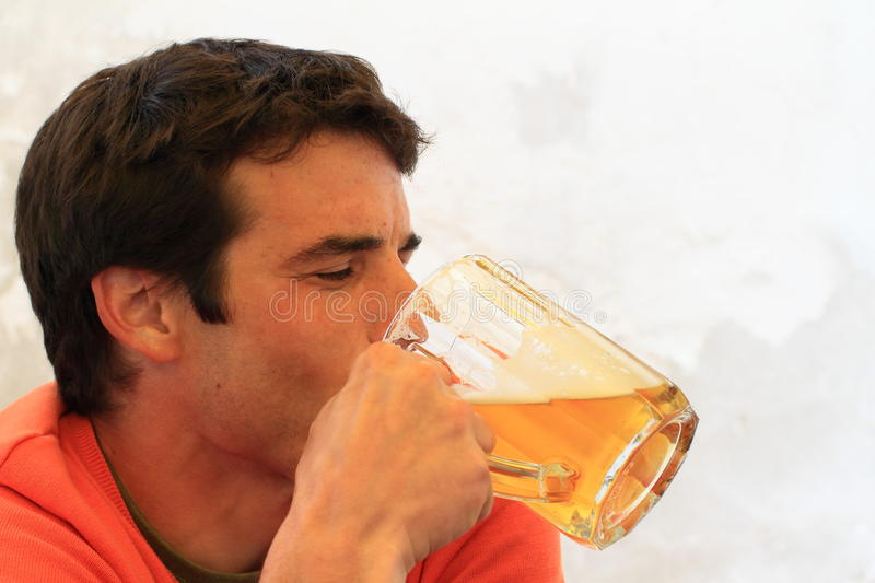 Download Young man drinking beer stock image. Image of restaurant - 39506043