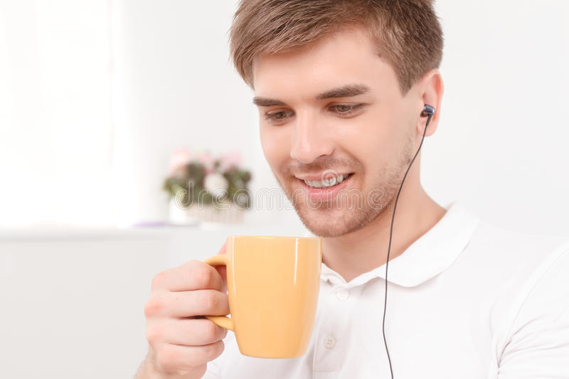 Young man drinking coffee royalty free stock photos