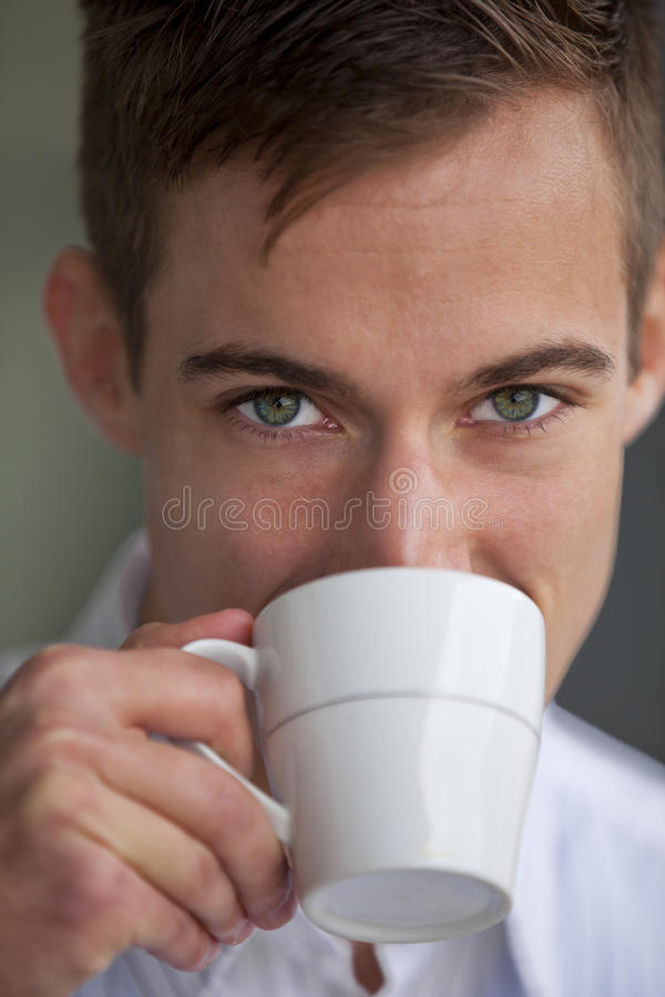 Young man drinking something stock images