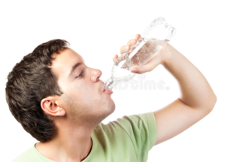 Download Young Man Drinking Water From Bottle Isolated Stock Photo - Image: 20896606