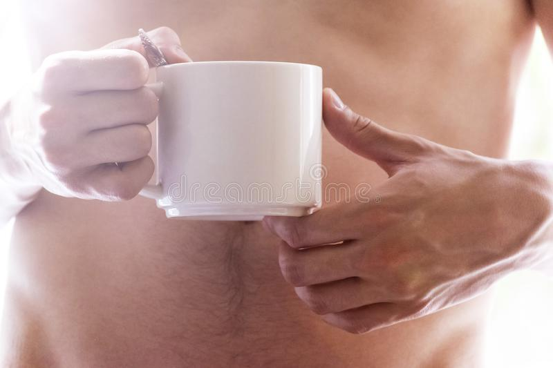Young man drinks coffee morning, summer, autumn. The concept of comfort, warmth, hearth.  stock image
