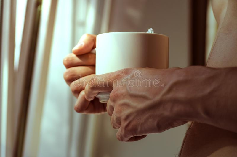 Young man drinks coffee morning, summer, autumn. The concept of comfort, warmth, hearth.  stock images