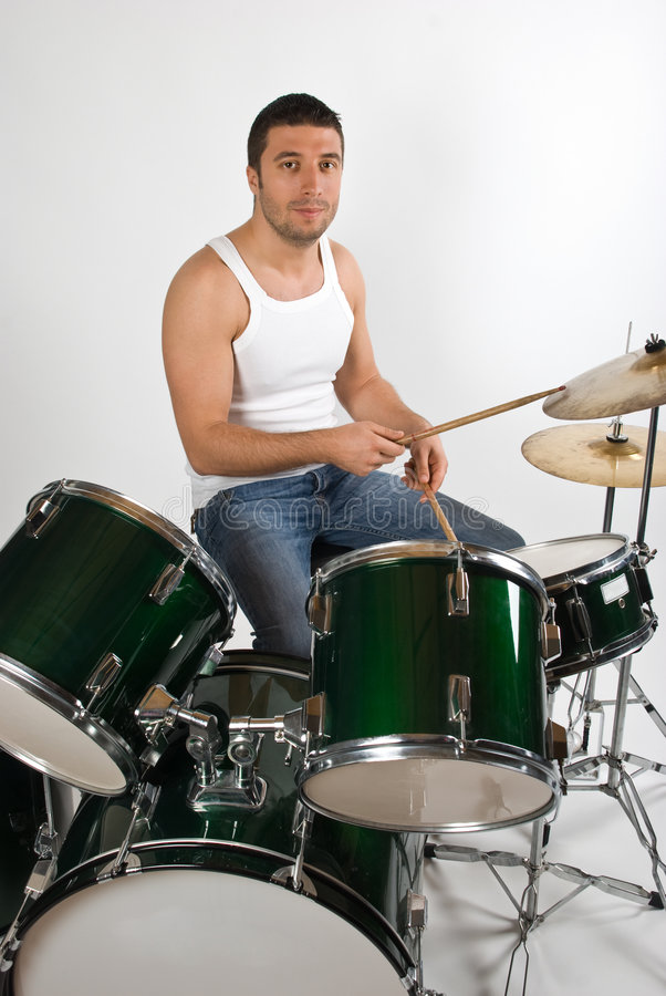 Young man drummer stock photography