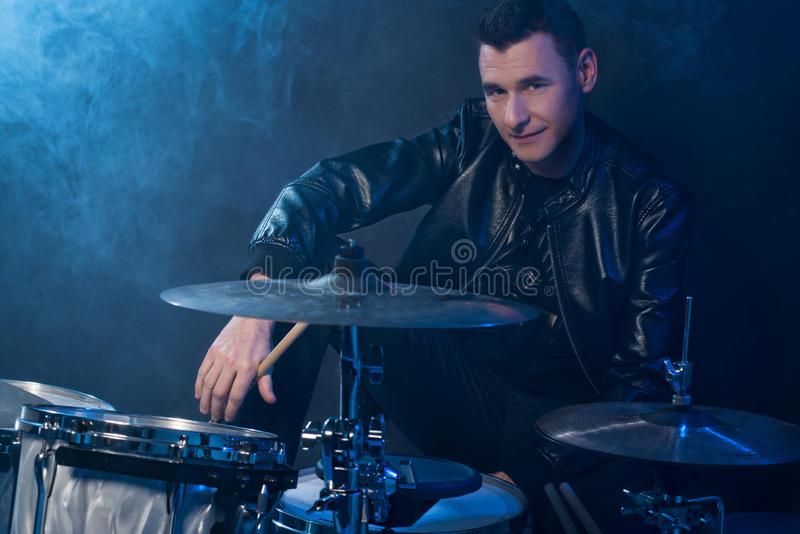 Young man with drums stock photo
