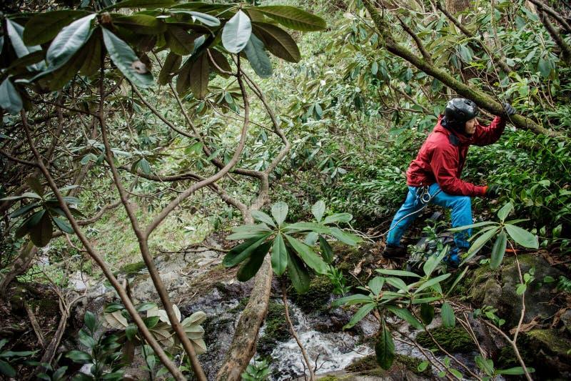 Young man dulfers down the mountains in Adjara. Young man in red jacket dulfers down the mountains in Adjara stock images