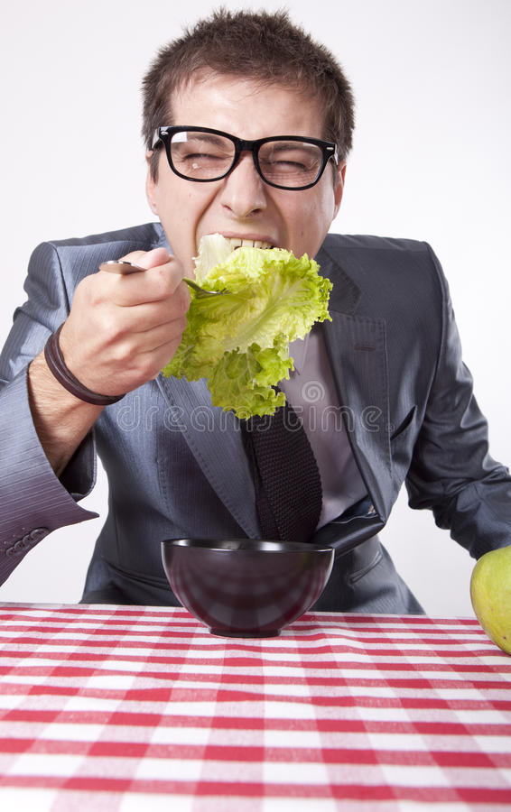 Download Young man eating stock photo. Image of hold, diet, lifestyle - 26347952