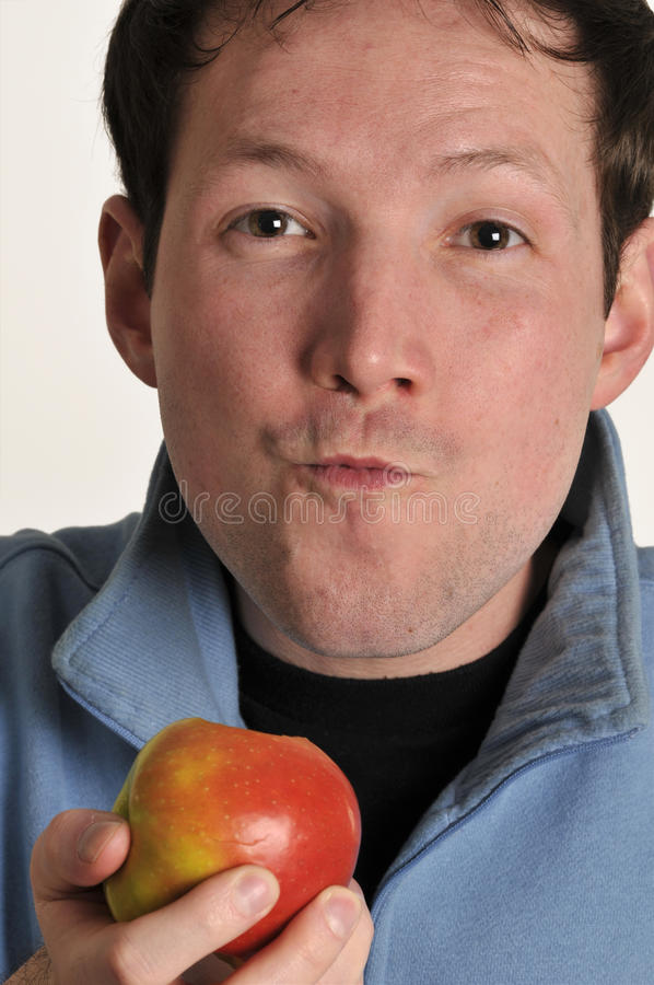 Young man eating apple royalty free stock photos