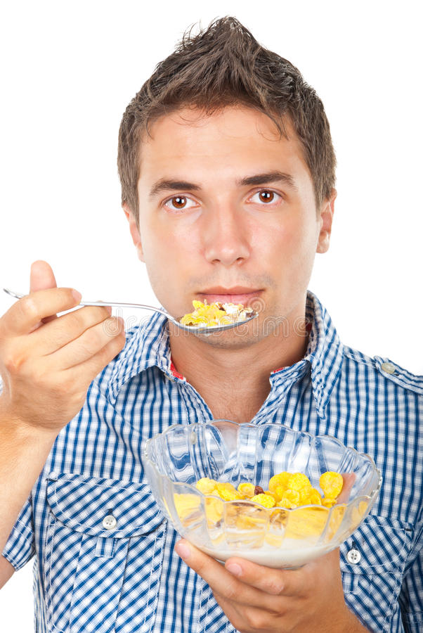 Young Man Eating Cornflakes Cereals Royalty Free Stock Images