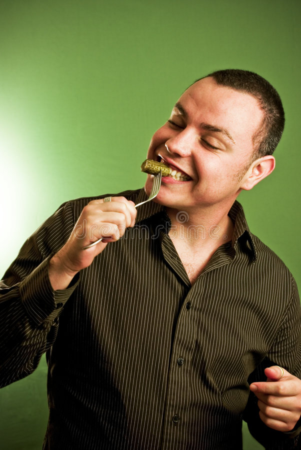 Free Young Man Eating From Fork Royalty Free Stock Photography - 3521407