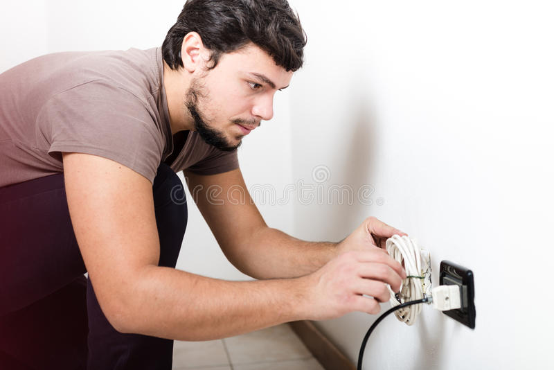 Young man electrician bricolage working. At home stock images