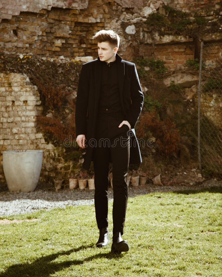 Young man in elegant black clothes royalty free stock photography