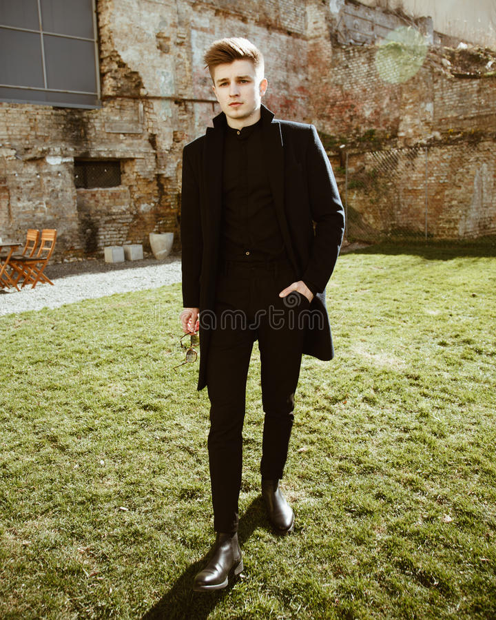 Young man in elegant black clothes royalty free stock photo
