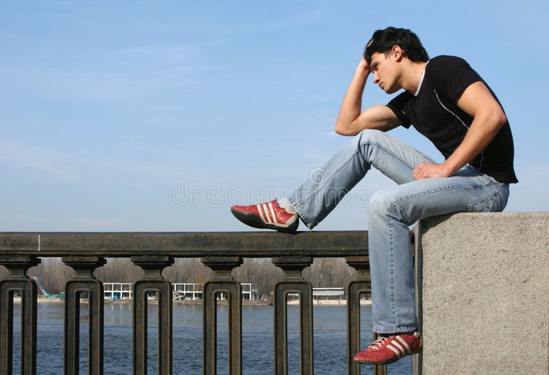 Young Man at the Embankment royalty free stock image