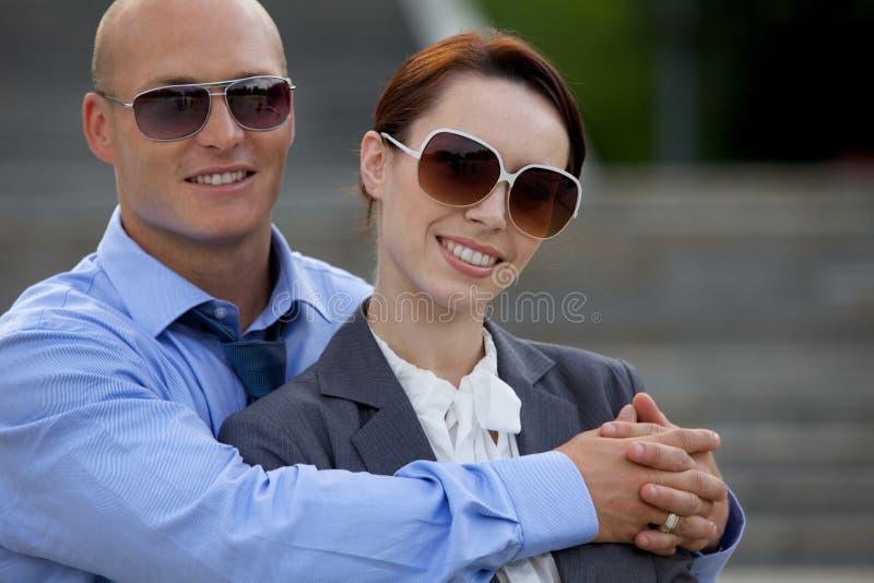Young man embracing woman stock image