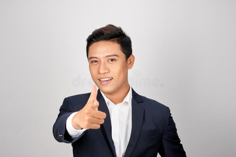 Young man employer dressed in business costume pointing finger on copyspace royalty free stock photo